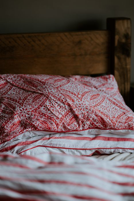 Pretty bedding can add a nice bit of colour to any room